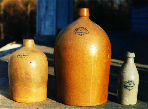 Stoneware jugs and beer bottles by C. Hermann & Co of Milwaukee